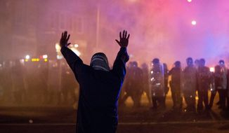 Baltimore erupted in violent face-offs with police during rioting this spring. The city is hoping federal taxpayers will help cover the costs of police, firefighters and other first responders, and the damage to city-owned property, which is estimated at $20 million. (Associated Press) ** FILE **