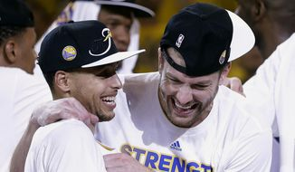 Golden State Warriors guard Stephen Curry, left, and forward David Lee celebrate after Game 5 of the NBA basketball Western Conference finals against the Houston Rockets in Oakland, Calif., Wednesday, May 27, 2015. The Warriors won 104-90 and advanced to the NBA Finals. (AP Photo/Ben Margot)