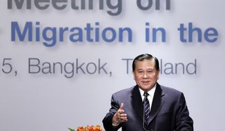 "Thai Foreign Minister Thanasak Patimaprakorn speaks at the ""Special Meeting on Irregular Migration in the Indian Ocean"" regarding the Rohingya and Bangladeshi migrant crisis at a hotel in Bangkok, Thailand. In the past month, more than 3,000 Rohingya Muslims fleeing persecution in Myanmar and impoverished Bangladeshis hoping to find jobs have landed on the shores of Indonesia, Malaysia and Thailand, drawing international attention to a crisis in Southeast Asia. (AP Photo/Charles Dharapak, File)"