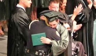 Lt. Eric Ellison is being widely praised after he attended the graduation ceremony of 18-year-old Kazzie Portie, whose parents were killed by a drunk driver less than a week earlier. (12 News/Lindsey Stanley Frugal)