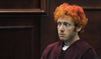 In this July 23, 2012, file photo, James Holmes, who is charged with killing 12 moviegoers and wounding 70 more in a shooting spree in a crowded theatre in Aurora, Colo., in July 2012, sits in Arapahoe County District Court in Centennial, Colo. (RJ Sangosti, Denver Post via AP, Pool, File)