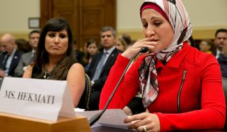 Sarah Hekmati (right), whose brother Amir Hekmati has been detained in Iran, speaks to Congress about her family. She is accompanied by Naghmeh Abedini (left), wife of detained U.S. citizen Saeed Abedini. (Associated Press)