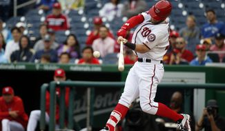 Washington Nationals' Bryce Harper hits an RBI single during the fifth inning of the first baseball game in a doubleheader against the Toronto Blue Jays, Tuesday, June 2, 2015 in Washington. (AP Photo/Alex Brandon)