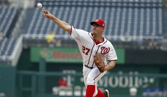 Washington Nationals starting pitcher Jordan Zimmermann throws during the first inning in the first baseball game of a doubleheader against the Toronto Blue Jays at Nationals Park, Tuesday, June 2, 2015, in Washington. (AP Photo/Alex Brandon)
