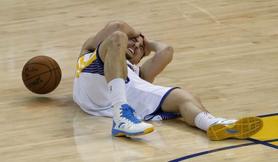 """File-This May 27, 2015, file photo shows Golden State Warriors guard Klay Thompson on the court after being injured during the second half of Game 5 of the NBA basketball Western Conference finals against the Houston Rockets in Oakland, Calif. When NBA union chief Michele Roberts watched Stephen Curry return to a game after his head slammed against the floor and he walked woozily to the locker room, she immediately boned up on the league's concussion protocols.  Two nights later, when Curry's Golden State teammate Klay Thompson was cleared to return after being kneed in the head only to later be diagnosed with a concussion, her reaction was much stronger.  """"It mortified me,"""" she said.  (AP Photo/Tony Avelar, File)"""