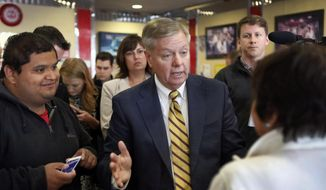 Republican presidential candidate,  Sen. Lindsey Graham, R-S.C., talks to customers during a campaign stop at MaryAnn's Diner, Tuesday, June 2, 2015, in Derry, N.H. (AP Photo/Jim Cole)