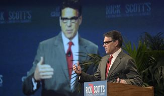 Former Texas Gov. Rick Perry speaks during Rick Scott's Economic Growth Summit in Lake Buena Vista, Fla., Tuesday, June 2, 2015. (AP Photo/Phelan M. Ebenhack)