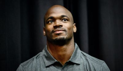 Vikings running back Adrian Peterson waits as head coach Mike Zimmer speaks at a news conference in Eden Prairie, Minn., Tuesday June 2, 2015.  Peterson practiced with the Vikings for the first time in nine months on Tuesday.   (GLEN STUBBE/Star Tribune via AP)  MANDATORY CREDIT; ST. PAUL PIONEER PRESS OUT; MAGS OUT; TWIN CITIES LOCAL TELEVISION OUT
