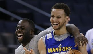 Golden State Warriors' Draymond Green, left, and Stephen Curry laugh during NBA basketball practice, Wednesday, June 3, 2015, in Oakland, Calif. The Warriors host the Cleveland Cavaliers in Game 1 of the NBA Finals on Thursday. (AP Photo/Ben Margot)