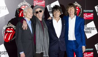 In this Thursday, July 12, 2012, file photo, from left, The Rolling Stones' Charlie Watts, Keith Richards, Ronnie Wood and Mick Jagger pose for photographers as they arrive at a central London venue to mark the 50th anniversary of their first performance. (AP Photo/Jonathan Short, File)