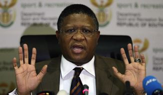 "South Africa's sports minister Fikile Mbalula gestures as he speaks during a news conference in Johannesburg, South Africa, Wednesday, June 3, 2015.  Mbalula ""categorically"" denied on Wednesday that the $10 million paid to former FIFA official Jack Warner in 2008 was a bribe for his help in securing the World Cup. (AP Photo/Themba Hadebe)"