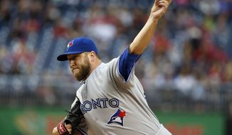 Toronto Blue Jays starting pitcher Mark Buehrle (56) throws during the first inning of a baseball game against the Washington Nationals at Nationals Park, Wednesday, June 3, 2015, in Washington. (AP Photo/Alex Brandon)