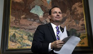 Sen. Mike Lee, R-Utah, concludes a conference call in his Capitol Hill office in Washington, Wednesday, June 3, 2015, with representatives from religious nonprofits that are concerned about how the Supreme Court's upcoming gay marriage decision will affect their institutions and members of the media. (AP Photo/Susan Walsh)