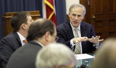 Texas Gov. Greg Abbott, right, talks with news reporters during a round table talk in his office at the Texas Capitol, Wednesday, June 3, 2015, in Austin, Texas. (AP Photo/Eric Gay)