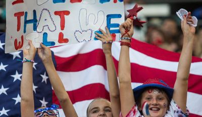 The United States fans cheer during a soccer friendly match against Mexico, on Sunday May 17, 2015, at StubHub Center? in Carson, Calif. The U.S. won 5-1. AP Photo/Ringo H.W. Chiu)