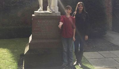 Jessica and her brother in front of the statue of William Wilberforce in the home that Wilberforce grew up in at Hull, England where Jessica did some of her research.