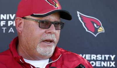 Arizona Cardinals head coach Bruce Arians talks to the media after an NFL football organized team activity Monday, June 1, 2015, in Tempe, Ariz. (AP Photo/Ross D. Franklin)