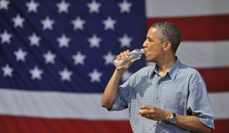 President Obama drinks from a bottle of water after his speech at Washington Park in Sandusky, Ohio, on July 5, 2012. Obama is on a two-day bus trip through Ohio and Pennsylvania. (Associated Press) **FILE**