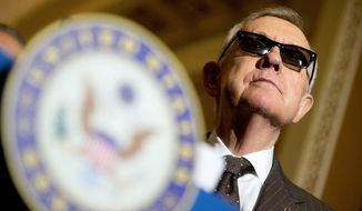 Senate Minority Leader Sen. Harry Reid of Nevada attends a news conference on Capitol Hill in Washington, in this Tuesday, June 2, 2015, file photo. (AP Photo/Andrew Harnik)