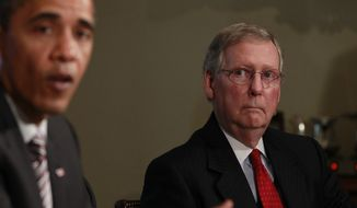 President Obama makes a statement to reporters as Senate Republican Leader Mitch McConnell of Kentucky looks on after a meeting regarding the BP Deepwater Horizon in the Cabinet Room at the White House in Washington on June 10, 2010. (Associated Press) **FILE**