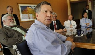 Ohio Gov. John Kasich speaks during a luncheon meeting with area business leaders, Friday, June 5, 2015, in Concord, N.H. Kasich is on a two-day swing through the nation's earliest presidential primary state as he considers a run for the Republican nomination for president. (AP Photo/Jim Cole)