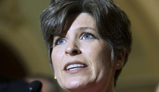 """FILE - In this May 19, 2015 file photo, Sen. Joni Ernst, R-Iowa, speaks during a news conference on Capitol Hill in Washington. It's time for Republican presidential contenders to """"Roast and Ride,"""" a new twist in Iowa's down-home presidential politicking. A weekend gathering Ernst features a pig roast, speeches from seven 2016 hopefuls and a motorcycle ride that promises to get at least a few of them on wheels. It's a prime political event for Republicans in a state known for a straw poll that is declining in relevance and for an annual steak fry for Democrats that had its last hurrah last year. (AP Photo/Evan Vucci, File)"""