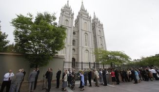"People wait in line outside the Mormon Temple before attending a public funeral for L. Tom Perry, a member of The Church of Jesus Christ of Latter-day Saints' highest governing body, the Quorum of the Twelve Apostles,  Friday, June 5, 2015, in Salt Lake City. Perry died Saturday, just 40 days after being diagnosed with rare anaplastic thyroid cancer that his family said spread like ""wildfire."" (AP Photo/Rick Bowmer)"