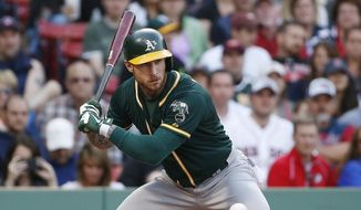 Oakland Athletics' Brett Lawrie takes ball four while pinch-hitting during the eighth inning of a baseball game against the Boston Red Sox in Boston, Saturday, June 6, 2015. (AP Photo/Michael Dwyer)