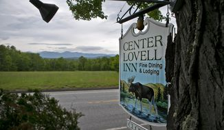 The Center Lovell Inn's roadside sign is seen Friday, June 5, 2015, in Lovell, Maine. Janice Sage, who took ownership of the inn by winning an essay contest 22 years ago will announce the winner of a second contest aimed at finding a new owner on Saturday, June 6. The three-story inn has seven guestrooms and stunning views of the White Mountains. (AP Photo/Robert F. Bukaty)