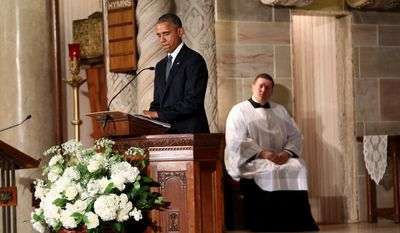 President Obama pauses while delivering the eulogy in honor of former Delaware Attorney General Beau Biden, Saturday, June 6, 2015, at St. Anthony of Padua Church in Wilmington, Del. (Associated Press) ** FILE **