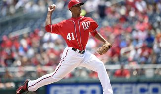 Washington Nationals starting pitcher Joe Ross delivers a pitch against the Chicago Cubs during the first inning of a baseball game, Saturday, June 6, 2015, in Washington. (AP Photo/Nick Wass)