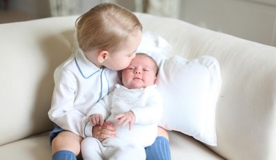 This image made available by Kensington Palace Saturday and taken by Kate, Duchess of Cambridge, at Amner Hall, eastern England, in mid-May 2015 shows Britain's Princess Charlotte being held by her brother, 2-year-old, Prince George. (Associated Press)