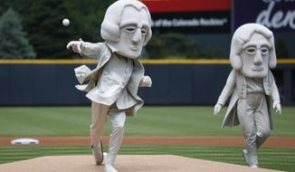 As part of an effort to promote tourism in the Black Hills of South Dakota, one of the U.S. Presidents depicted in the sculpture in the granite face of Mount Rushmore, George Washington, throws out the ceremonial first pitch under the watch of Thomas Jefferson before the Colorado Rockies host the Miami Marlins in a baseball game Sunday, June 7, 2015, in Denver. (AP Photo/David Zalubowski)