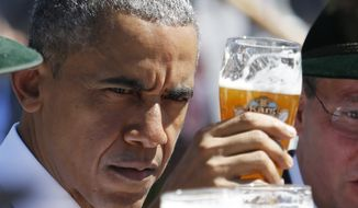 U.S. President Barack Obama toasts with a glass of beer during a visit to the village of Kruen, southern Germany, Sunday, June 7, 2015 prior to the G-7 summit in Schloss Elmau hotel near Garmisch-Partenkirchen starting later the day. (AP Photo/Markus Schreiber)