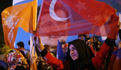 Supporters of Turkey's ruling Justice and Development Party celebrate the election results in Istanbul late Sunday. (Associated Press)