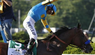 Victor Espinoza reacts after crossing the finish line with American Pharoah (5) to win the 147th running of the Belmont Stakes horse race at Belmont Park, Saturday, June 6, 2015, in Elmont, N.Y.  American Pharoah is the first horse to win the Triple Crown since Affirmed won it in 1978.(AP Photo/Kathy Willens)