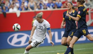 United States' Abby Wambach's (20) header goes wide against Australia during the first half of a FIFA Women's World Cup soccer match in Winnipeg, Manitoba, Monday, June 8, 2015. (John Woods/The Canadian Press via AP) MANDATORY CREDIT