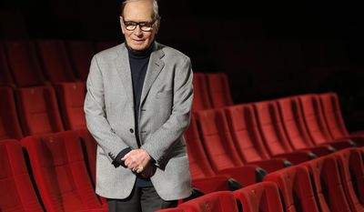 FILE -- In this Dec. 6, 2013 file photo Ennio Morricone, composer and conductor from Italy, poses during a photo call to promote his German 2014 concerts, in Berlin. Oscar-winning Italian composer Ennio Morricone this week will premiere a Mass he composed to mark the 200th anniversary of the restoration of the Jesuit order and named for its most illustrious member, Pope Francis. (AP Photo/Michael Sohn, File)