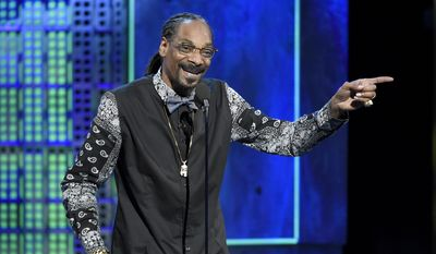 In this March 14, 2015, file photo, Snoop Dogg speaks at the Comedy Central Roast of Justin Bieber at Sony Pictures Studios in Culver City, Calif. (Photo by Chris Pizzello/Invision/AP, File)