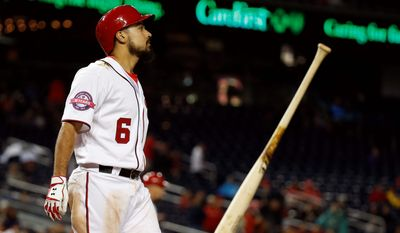 The Nationals' Anthony Rendon throws his bat after striking out in a loss last week at home to the Chicago Cubs. The Nationals say they aren't worried about their poor stretch. (Associated Press)