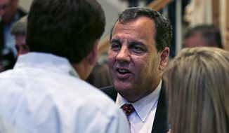 New Jersey Gov. Chris Christie talks with guests at a house party in Bedford, N.H., Monday, June 8, 2015.  Christie is testing the waters as he considers a run for the Republican nomination for president in the nation's earliest presidential primary state. (AP Photo/Charles Krupa)