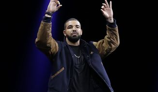 Musician Drake gestures during the Apple Worldwide Developers Conference in San Francisco on June 8, 2015. The maker of iPods and iPhones introduced Apple Music, its new streaming-music service. (Associated Press) **FILE**