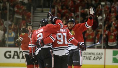 Chicago Blackhawks' Brad Richards (91) is congratulated by teammates after scoring during the first period of Game 3 of the Stanley Cup Finals against the Tampa Bay Lightning Monday, June 8, 2015, in Chicago.  (AP Photo/Nam Y. Huh)