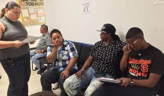 Gay couples, from left, Kathleen M. Aguero, Loretta M. Pangelinan, Nikki Dismuke and Deasia Johnson apply for marriage licenses in Hagatna, Guam, Tuesday, June 9, 2015. Guam became the first U.S. territory to recognize gay marriage. (AP Photo/Grace Garces Bordallo)