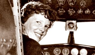 In this May 20, 1937, photo, provided by The Paragon Agency, shows aviator Amelia Earhart at her Electra plane cabin, taken by Albert Bresnik at Burbank Airport in Burbank, Calif. It was a clear spring day in 1937 when Amelia Earhart, ready to make history by flying around the world, brought her personal photographer to a small Southern California airport to document the journey's beginning. (Albert Bresnik/The Paragon Agency via AP)