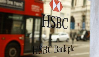 HSBC Holdings, Britain's largest bank by market value, will cut between 22,000 and 25,000 jobs around the world in an attempt to reduce costs and shift its centre of gravity back towards fast-growing Asian economies. (Associated Press)