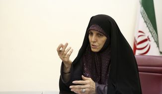 Vice President for Women and Family Affairs Shahindokht Molaverdi speaks in an interview with The Associated Press at her office in Tehran, Iran, Monday, June 8, 2015. Molaverdi said a limited number of women will be allowed to watch Volleyball World League games in Tehran later this month as it lifts a ban on Iranian women attending male sporting events. (AP Photo/Ebrahim Noroozi)