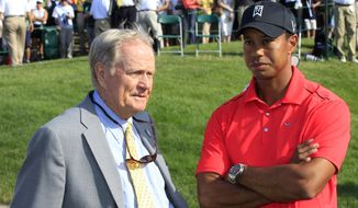 "FILE - In this June 3, 2012, file photo, Jack Nicklaus, left, and Tiger Woods talk after Woods won the Memorial golf tournament at the Muirfield Village Golf Club in Dublin, Ohio. Nicklaus gets asked more about Tiger Woods than he ever did about the golf ball. Only now, the nature of the question has changed dramatically. It has gone from ""Do you think Tiger will break your record?"" to ""What's wrong with Tiger?"" The answer is the same. Nicklaus doesn't know. Woods might not, either. (AP Photo/Tony Dejak, File)"