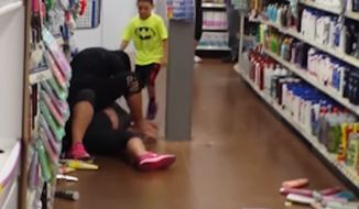 Police in Beech Grove, Indiana, are investigating a now-viral video of two women engaging in an all-out brawl Thursday in the aisles of Wal-Mart. (YouTube/Brian Marye)