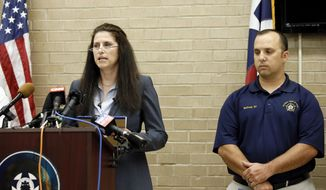 Jane Bishkin, left, the Dallas County Police Officer's Association attorney who represents former McKinney Officer Eric Casebolt, holds a news conference, Wednesday, June 10, 2015, in Dallas. Casebolt is the white police officer who resigned after being caught on video pushing a black teenage girl to the ground outside a pool party. At right is Daniel Malenfant, lodge president of the McKinney Fraternal Order of Police. (AP Photo/Tony Gutierrez)